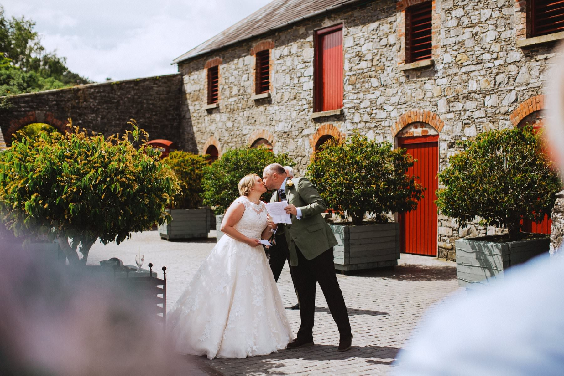 bride and groom kiss after speech at larchfield estate