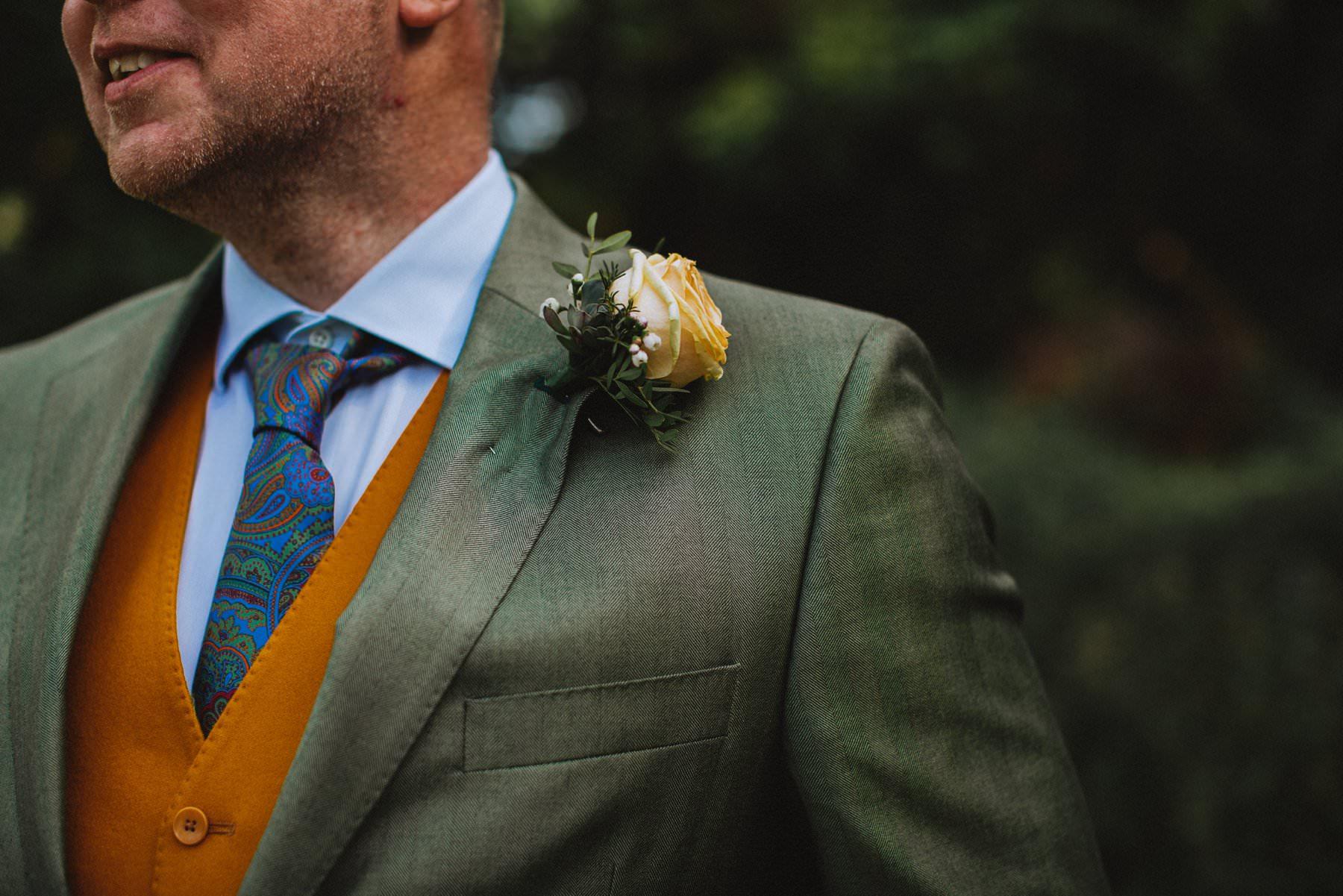 green jacket and yellow waistcoat for groom